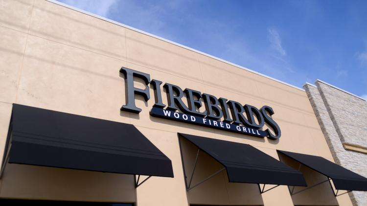 Florida's first Firebirds Wood Fired Grill resides in Orlando's Market at Mills Park.