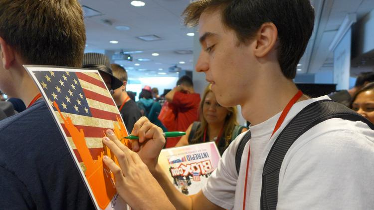 Holden resident Josh Correira signing an autograph at a BLOXcon fan event last summer in New York City.
