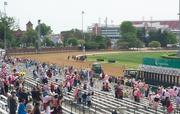 The crowd still was sparse as the horses headed into the homestretch in the first race.