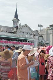 Plenty of hats and plenty of pink in the paddock area at Churchill Downs.