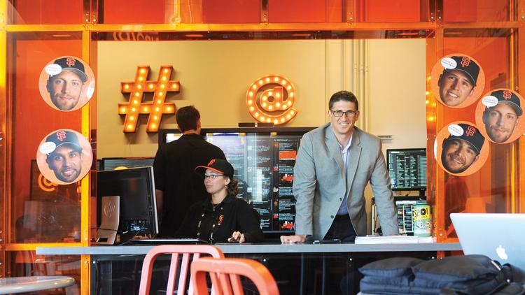 Giants social media director Bryan Srabian at @Cafe, where fans can grab coffee and watch TV screens that show Instagram photos and what other baseball fans are saying on Twitter.