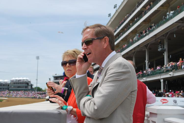 Greater Louisville Inc. chairman Kerry Stemler and his wife, Debbie Stemler, watched the races on Oaks Day from the trackside winner's circle.
