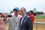 Louisville Mayor Greg FIscher and his brother, Chris Fischer, posed for a photo in the winner's circle.