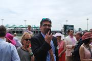CafePress Inc. CEO Bob Marino talked on his smartphone from the winner's circle at Churchill Downs on Oaks Day.