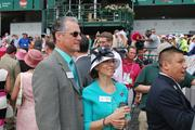 Two of GLI's guests on Oaks Day watched the activity on the racetrack.
