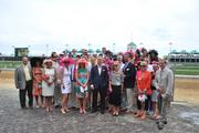 Guests of GLI and Louisville Mayor Greg Fischer posed with their hosts in the winner's circle following and Oaks Day race.