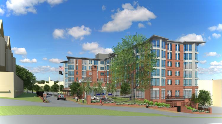 An artist rendering of the proposed apartment building in Brighton by the Brighton Marine Health Center.