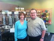 The Oilerie franchisee Cindy Hoffman stands with founder Curt Campbell at the company's newest location at The Greene.