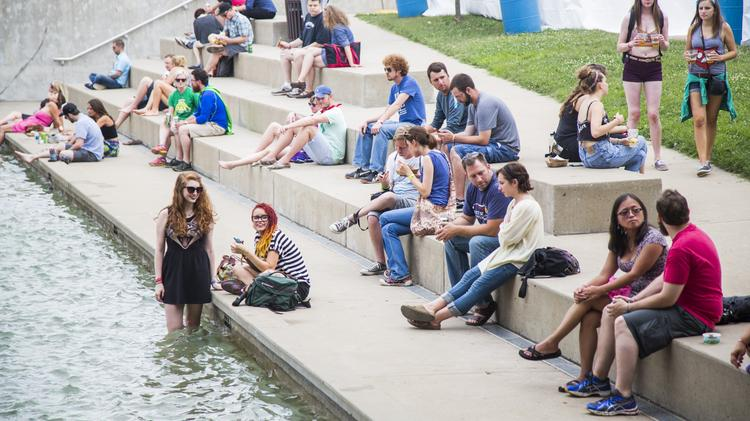 The steps next to the wading pools at Waterfront Parked served as good place for Forecastle Festival fans to rest and cool off.