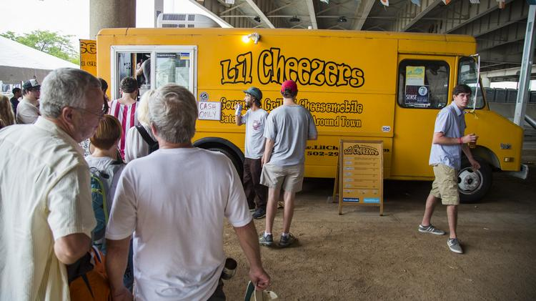 The Lil Cheezers food truck found its home for the weekend just beyond the busy Boom Stage at The Forecastle Festival.