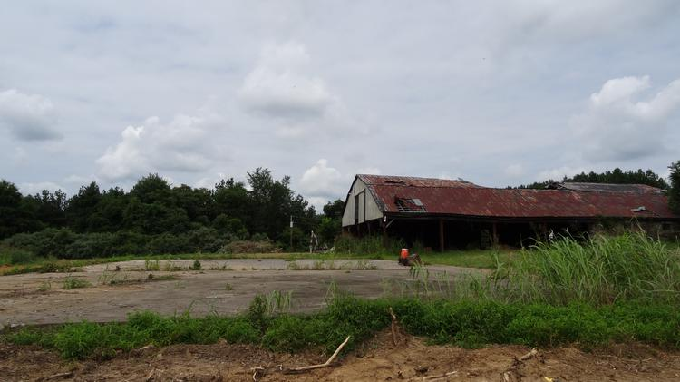 JK Moving Services' Chuck Kuhn, owned of the 540-acre Egypt Farm in Purcellville, is pitching a heliport on the concrete pad, seen here, and a hanger for his Eurocopter in place the deteriorating barn. And neighbors are not happy about it.
