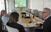 A legal team offers pro bono services to a business owner in Virginia, Minn., via video conference. From left: Medtronic's Senior Paralegal Diane Kessler and Senior Patent Director Mary Bauman, and Maslon attorney Martin Rosenbaum