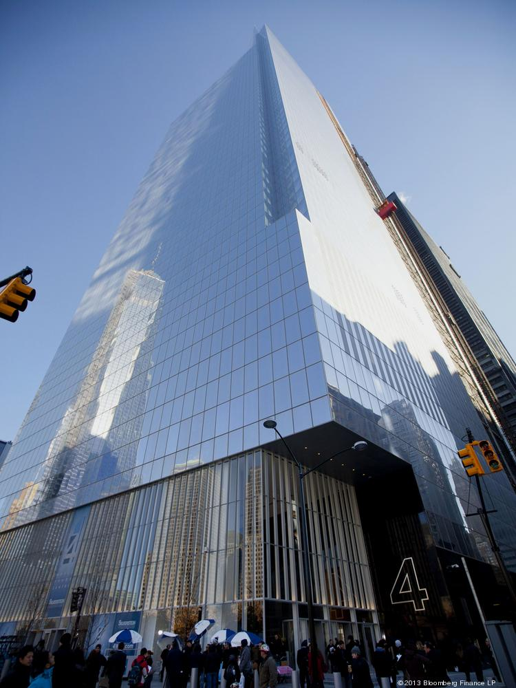 Pedestrians pass in front of the 4 World Trade Center building during a dedication ceremony in November 2013. The 72-story building designed by architect Fumihiko Maki officially opened as a committee of architects recognized One World Trade Center as the tallest skyscraper in the U.S.