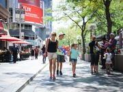 Families stroll along the mall at the Meet in the Street event Sunday, July 20.