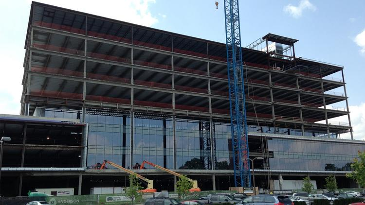 This photo, taken July 21, shows the windows that have been installed on the first three floors of Rookwood Exchange's office tower.