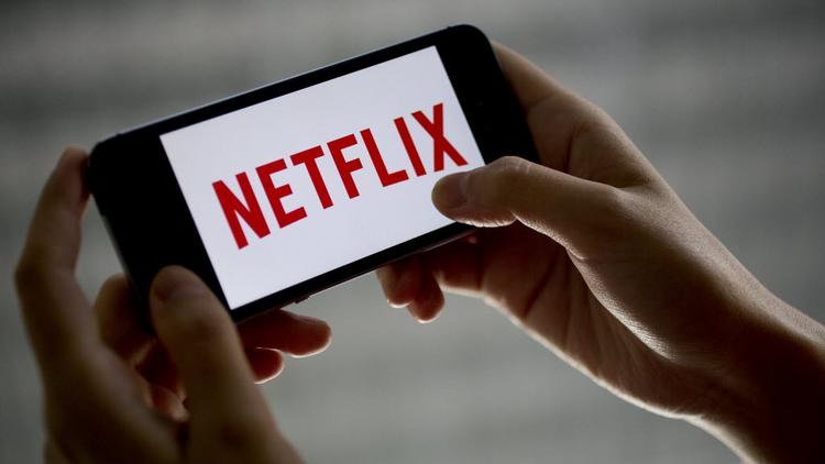 Netflix Inc. added more subscribers in the second quarter than it projected, and its shares rose slightly in after hours trading. The company's revenue number hit analyst's estimates while profit just missed.