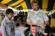 Mark Ayers, right, architect at Ferraro Choi and Associates, shared hands-on exhibits about stormwater management, recycled material reuse and heat-island effect with students at the Punahou School Sustainability Fair. Ayers is a volunteer member of American Institute for Architects – Honolulu Chapter Committee on the Environment.