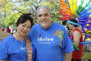 Kandis McIntosh, left, registered nurse/patient care coordinator for Kaiser Permanente, and Dr. Drew Kovach, director of HIV services for Kaiser Permanente, participate in the AIDS Walk 2013 at Kapiolani Park.