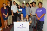 Enterprise Branch Manager Will Cirksena and Enterprise employee and Big Sister Valerie Bonilla present Big Brothers Big Sisters Hawaii staff with a check for $1,500 from the Enterprise Holdings Foundation.