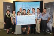 The Bank of Hawaii Foundation recently presented $100,000 to the Kapiolani Health Foundation in support of its Campaign for Hawaii's Children. From left, Donna Tanoue, Jeanette Sugai, Erin Sugai, Martha Smith, Cody Sugai, Michelle Ho, Scott Sugai, Peter Ho and Michael J. Robinson.