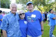 From left, Honolulu Mayor Kirk Caldwell, Mary Anne Burak and Bank of Hawaii Managing Committee Vice Chairman Peter Biggs at Bank of Hawaii's 7th Annual Community Walk at the Honolulu Zoo.