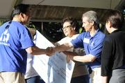 Peter Ho, left, chairman, president and CEO of Bank of Hawaii, presents a check for $105,636 to be divided equally between EPIC Ohana, Lanakila Pacific and YMCA of Honolulu at BOH's 7th Annual Community Walk at the Honolulu Zoo. BOH employees selected the walk's beneficiaries then raised the money to support community organizations. From left,  Ho, Laurie Tochiki of EPIC Ohana, Michael Doss of YMCA of Honolulu and Donna Tanoue, president of the BOH Foundation.