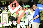 Peter Ho, right, chairman, president and CEO of Bank of Hawaii, recognizes a Monopoly centipede team participating in the bank's centipede parade at Bank of Hawaii's 7th Annual Community Walk.