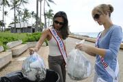 Shanmarie Alferez, left, Mrs. Hawaii - United States 2012, and Sarah Beppu, Mrs. East Oahu 2013, help to clean up Kakaako Waterfront Park with Divas Doing Good, the non-profit arm of Eden in Love and The Wedding Cafe.