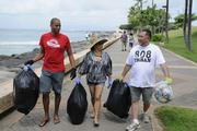 From left, Jerron Roberts, owner of Pop Pop Donuts, Melyssa Shimamoto, owner of Touch Mini Day Spa, and Ed Oshiro, owner of Kakaako.com, help clean up Kakaako Waterfront Park through a Divas Doing Good cleanup last month.