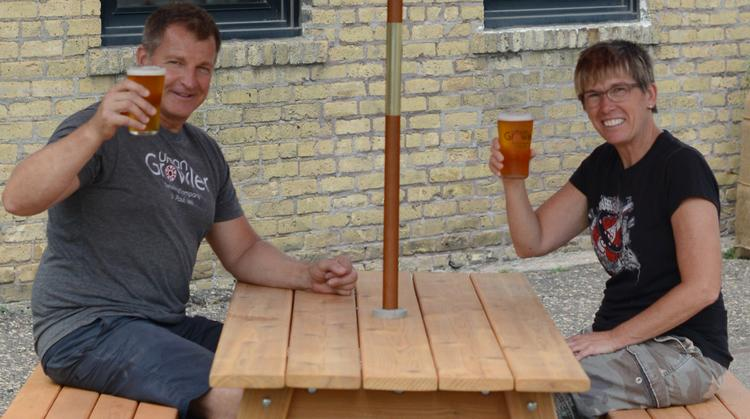 Urban Growler Operations Manager Thom Loch and Co-owner Jill Pavlak sample beer on the patio. Thom Loch is the brother of head brewer and Co-owner Deb Loch.