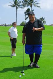 Chef Sam Choy participates in the 15th Annual Hawaii Culinary Education Foundation Charity Golf Tournament held at the Kapolei Golf Course.