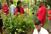 Rick Hadley, front, chairman and CEO of Hawaiian Springs, participates in planting native and endangered wild Hawaiian Gardenia in collaboration with the Plant Extinction Prevention Program of Hawaii and the Department of Land and Natural Resources Division of Forestry and Wildlife in Waianae Valley.