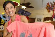 Nandini Bhattacharjee, owner of Nomads in Kailua, gives back to the Blindproject, a nonprofit based out of New York. Bhattacharjee sells the shirts, which were designed by a friend in Wisconsin, and approximately 50 percent of the sales go back to the project to help employ and provide job training for women screen printers.