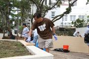 Keith Amemiya of Island Holdings helps to clean up Kamalii Park at the top of Bishop and Beretania streets in Downtown Honolulu. More than 60 employees and student volunteers from Our Lady of Perpetual Hope School participated in the quarterly cleanup.