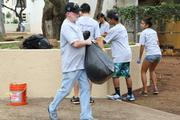 Pacxa President and CEO Gordon Bruce pitches in to clean up Kamalii Park at the top of Bishop and Beretania streets in Downtown Honolulu. More than 60 employees and student volunteers from Our Lady of Perpetual Hope School participated in the quarterly cleanup.