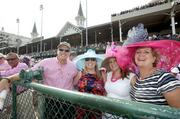 Carl Herde, CFO of Baptist Healthcare System Inc., and from left, daughters Megan and Amanda and wife Carleen, were at the track for the Kentucky Oaks.