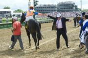 Javier Castellano, aboard Noble Tune, gets a high five after winning the American Turf.