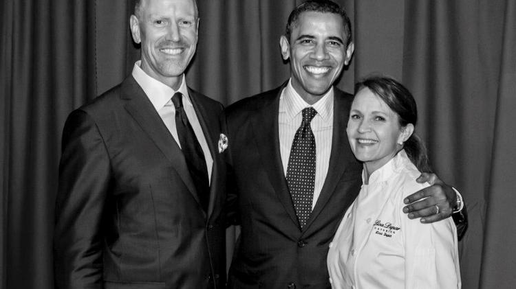 Left to Right, Jonathan Zimmer, President Barack Obama and Chef Lisa Dupar, at the home of former Costco chief Jim and Jan Sinegal, the first time she served the president at dinner. This is the fourth time Dupar has prepared food for this president.