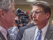 N.C. Gov. Pat McCrory speaks with Charlotte City Councilman Ed Driggs at a press conference Tuesday at the Charlotte Chamber.