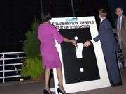 Mayor Stephanie Rawlings-Blake, left, attended the lighting of the beacon at HarborView Tower in Baltimore.