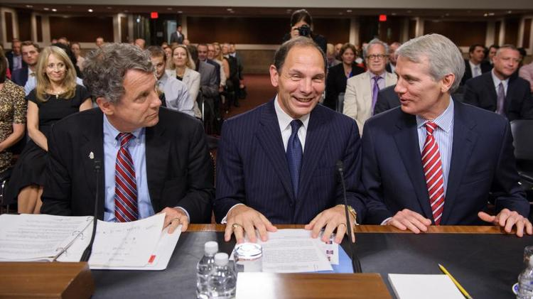 It looks as if new Department of Veterans Affairs Bob McDonald, center, will get a reformed health care system to run.