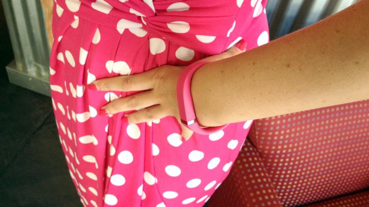 Staff writer Sonya Sorich models her pink Fitbit. She ordered it to test the Google Shopping Express service in the Sacramento region.