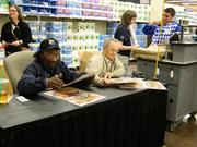Derby-winning jockey Ron Turcotte, right, who rode Secretariat to victory in all the Triple Crown races 40 years ago, signed autographs at the Middletown Kroger. At left is Charlie Davis, the training jockey who rode Secretariat.