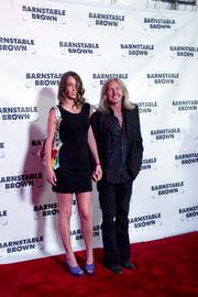 """Mark """"Sparky"""" Matejka, guitarist for the band Lynyrd Skynyrd, was photographed on the red carpet with his date."""