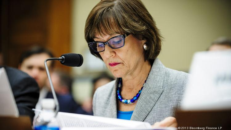 Lois Lerner, the director of the Internal Revenue Service's (IRS) exempt organizations office, looks through documents during a House Oversight and Government Reform Committee hearing in Washington, D.C., on May 22, 2013.