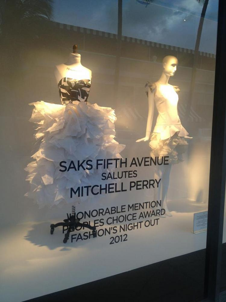 Mitchell Perry, a contestant on Project Runway, first had his work featured in the storefront of Saks Fifth Avenue.