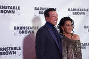 Singer Smokey Robinson posed on the red carpet with his date.
