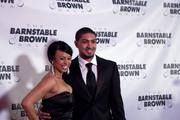 Peyton Siva, point guard for the University of Louisville 2013 NCAA men's national champion basketball team, posed for photos with his date on the red carpet.