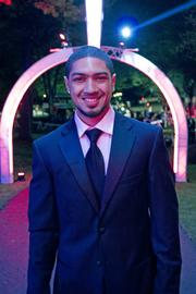 Peyton Siva, point guard for the University of Louisville 2013 NCAA men's basketball Champions, posed for a photo on the way up the driveway at the Barnstable Brown gala.