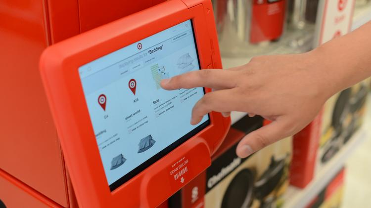 An example of new Target technology, this one a seamless service station that allows shoppers to check prices as well as text an associate in store with questions.